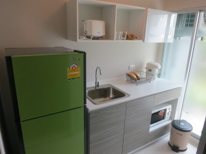 Kitchen with Frig, Microwave Owen, Electric Jar Pot, Toaster